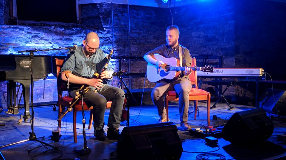 Ross performing uilleann pipes with Karson McKeown on guitar at St Brigid's Centre in Ottawa.